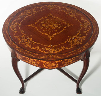 A Late 19th Century Marquetry Center Table with Hidden Games Top
