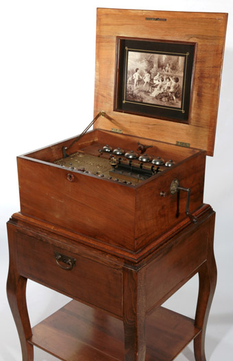 A Rare Polyphon Disc Music Box with 12 Bells and the Original Stand