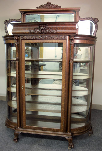 A Mirrored Oak Griffin China Cabinet