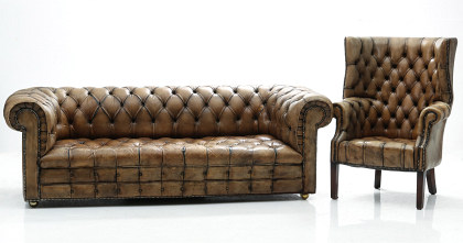 A Vintage Leather Chesterfield Sofa and Matching Wing‑Back