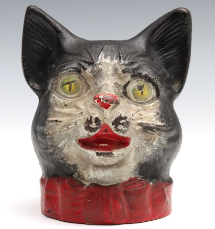 A Rare Cast Iron Cat Head String Holder